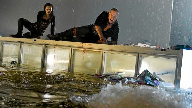 Phoebe Tonkin (Jaimie) and Martin Sacks (Todd) battle the great whites in <i>Bait 3D</i>.