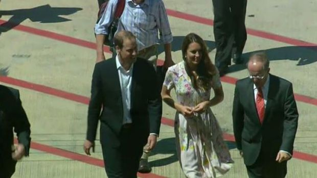 The Duke and Duchess on the tarmac at Brisbane International Airport early this afternoon.