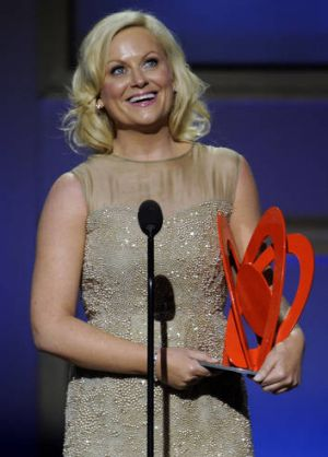 Amy Poehler presents the Emmys, along with Ricky Gervais and Louis C.K.
