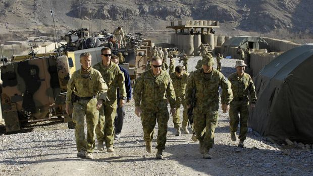 Tour of duty … Cantwell (centre) is briefed while at Patrol Base Qudus, in Afghanistan's Uruzgan province, in 2010.