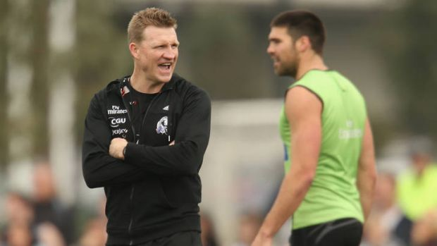 Collingwood coach Nathan Buckley with Chris Dawes at training.