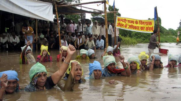 Standing toe to toe ... protesting village women shout slogans as they stand in water at Ghogal village, in the central ...