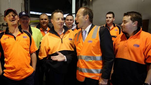<b> RISE AND SHINE: </b> Tony Abbott visits Fyshwick PFD foods wholesaler yesterday, too early to answer questions on ...