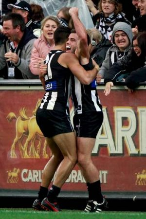 Magpies midfielder Jarryd Blair (right) is congratulated by teammate Sharrod Wellingham on Anzac Day.