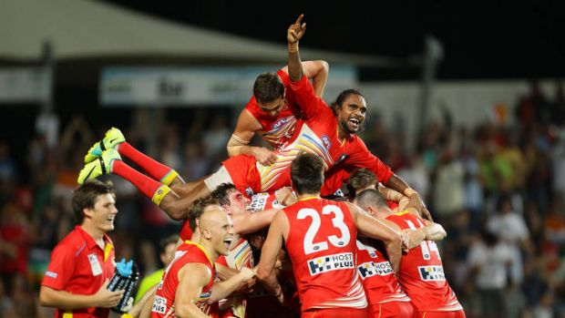 The Suns celebrate Karmichael Hunt's match-winning goal against Richmond.