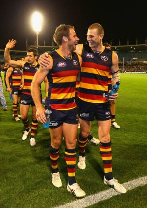 Crows Sam Jacobs and Ben Rutten celebrate after beating Fremantle in the semi-final.