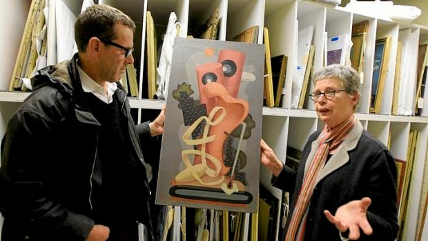 Andrew Donaldson and Dr Ann Stephen with a 1930s painting by the rediscovered avant-garde pioneer J.W. Power, titled ...