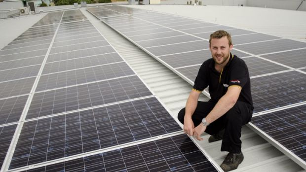 Queens SUPA IGA manager Stuart Bain shows off the store's new solar panels.