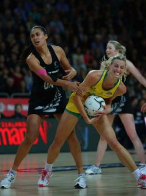 Mine: Australia's Laura Geitz holds onto the ball under pressure from Maria Tutaia.