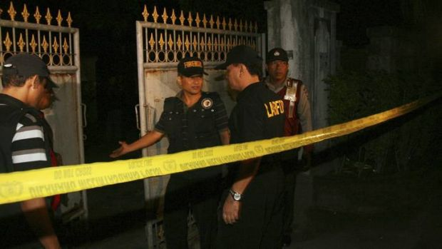 Members of a forensic team arrive at the site of a shooting in Sanur on the Indonesian island of Bali last March. ...
