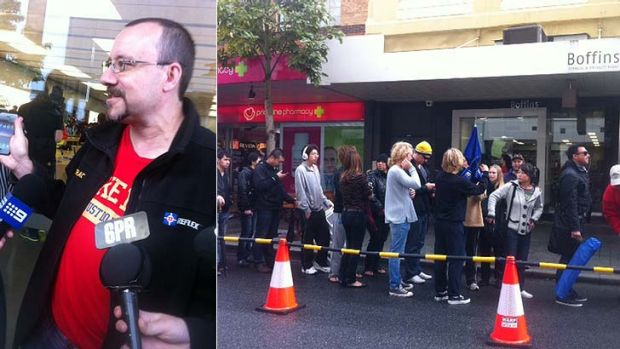 Stephen Quayle speaks to the media after getting the first iPhone 5; and Apple afficionados queue in the rain to get ...