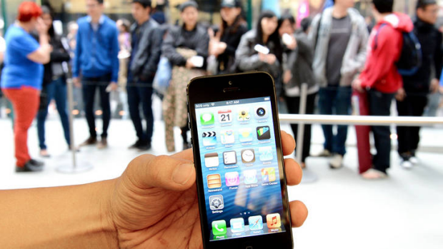People queue to buy Apple's new iPhone 5 from their flagship store in Sydney.