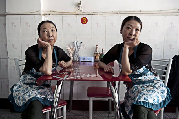 The sisters Jin by Hugh Rutherford. Ying and Lan, run the Chong Quing Twins Restaurant in Mianning County, Sichuan Province.