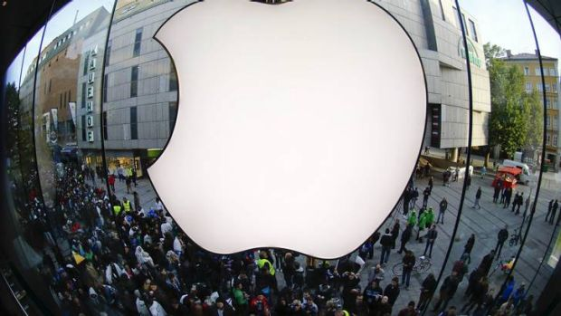 Customers gather outside an Apple store before the release of iPhone 5 in Munich early September 21, 2012.