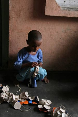 Seven-year-old Shama stitches balls in her village of Rasoolpur Chhodi, in India's Punjab. Shama says she sometimes goes ...