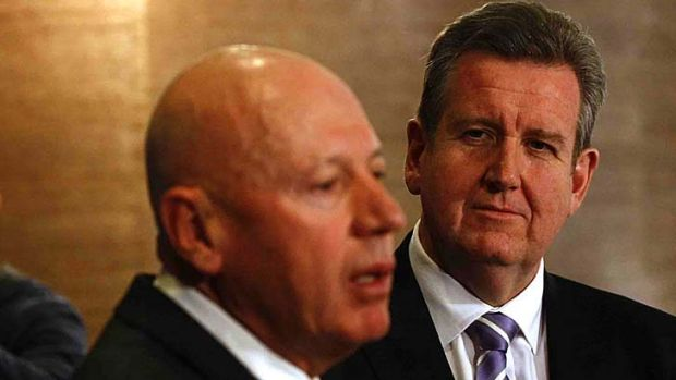 Finger-pointing ... Energy Minister Chris Hartcher and Premier Barry O'Farrell.