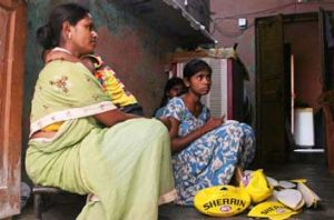 Disgraceful situation … Laxmi and daughters Sunali, 11, right, and Rupa, 10, stitch 15 balls a day in their ...