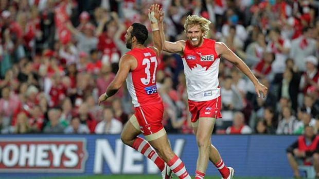 High five ... Adam Goodes and Lewis Roberts-Thomson starred in the Swan's 96-70 victory over Collingwood in the ...