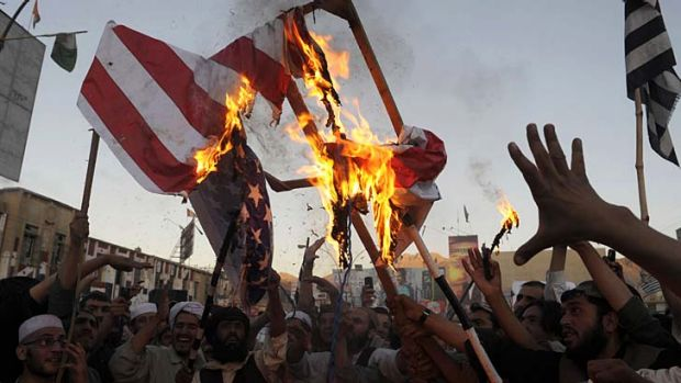 Angry: Pakistani Muslim demonstrators burn a US flag in Quetta to protest against an anti-Islam film that has been ...