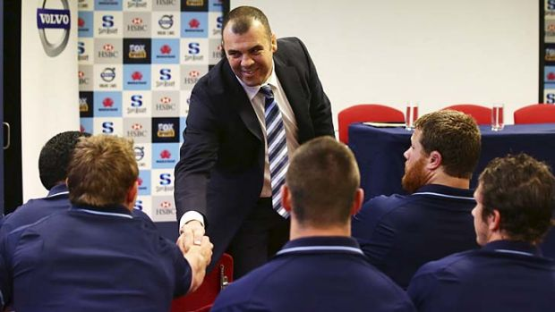 G'day fellas … Waratahs coach Michael Cheika greets the players at the press conference announcing his signing.