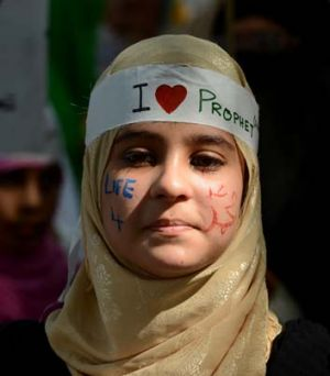"Protest rally ... a young Pakistani woman, her face adorned with the words ""Life 4 Holy Prophet Mohammed"" takes part in ..."
