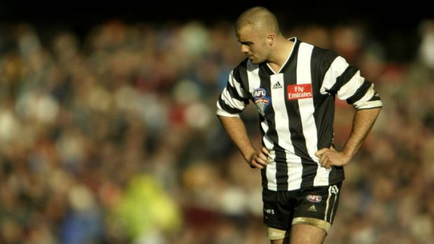 Low point: A dejected Rhyce Shaw after Collingwood lost the grand final  in 2003.