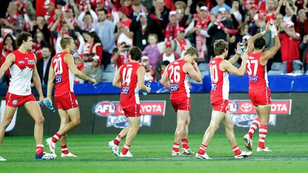 Proving the can overcome hoodoos ... Sydney players rejoice after finally defeating Collingwood and ending an 11-match ...
