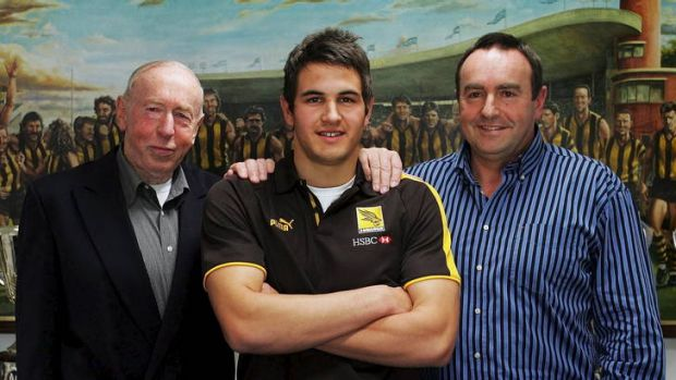 Family affair: Josh Kennedy with his grandfather John Kennedy snr and father, John Kennedy jnr, in 2006.