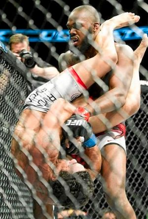 Jon Jones, top, drops Vitor Belfort on his head as he attempts to escape a Belfort armbar attempt during the light ...