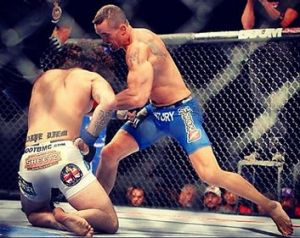 Kyle Noke (right) moves in for the kill against Charlie Brenneman at UFC 152. Photo posted on Instagram ...