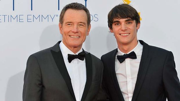 Actors Bryan Cranston and RJ Mitte arrive at the Emmy Awards.