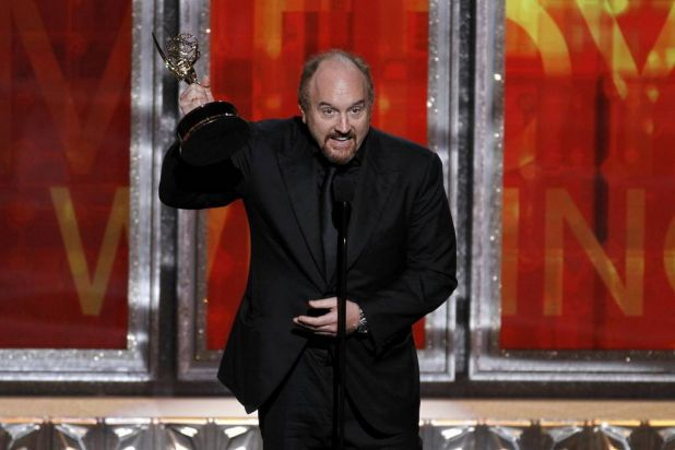 """Louis C.K. accepts the award for outstanding writing in a comedy series for his show """"Louie"""" at the 64th Primetime Emmy ..."""