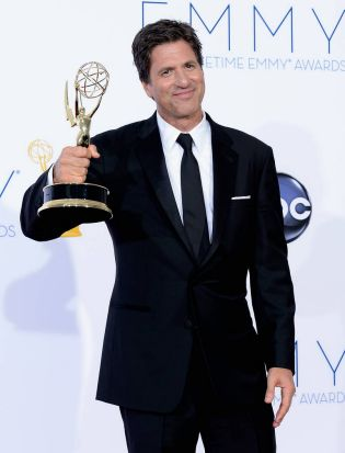 """Director Steven Levitan, winner Outstanding Directing for a Comedy Series for """"Modern Family,"""" poses in the press room ..."""