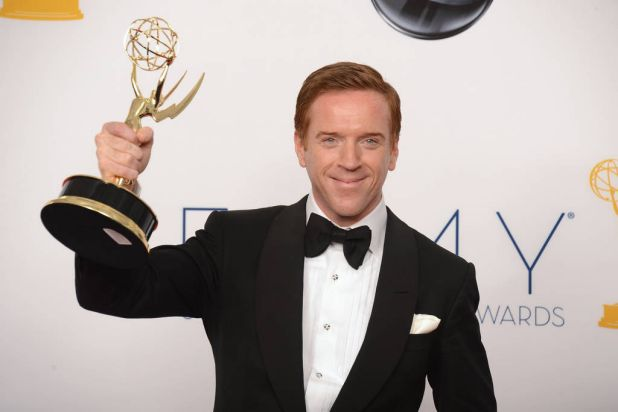 """Damian Lewis poses in the press room with his Outsanding Lead Actor in """"Homeland"""" at the 64th annual Prime Time Emmy ..."""