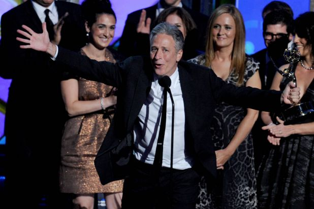 """Television personality Jon Stewart (C) and writer-producers accept Outstanding Variety, Music, or Comedy Series for """"The ..."""