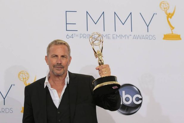 """Actor Kevin Costner poses with his award for outstanding lead actor in a miniseries or movie for """"Hatfields & McCoys"""" ..."""
