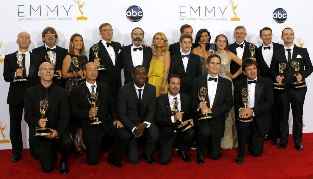 """Producers and actors, including stars Many Patinkin and Clair Danes (C), from the drama series """"Homeland"""" pose for ..."""