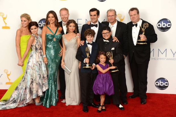 The cast of Modern Family poses in the press room at the 64th annual Prime Time Emmy Awards at the Nokia Theatre at LA ...