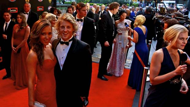 Adelaide's Rory Sloane with partner Belinda Riverso on the red carpet.