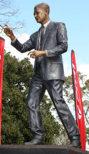 Larger than life: The statue of Norm Smith unveiled at the MCG.