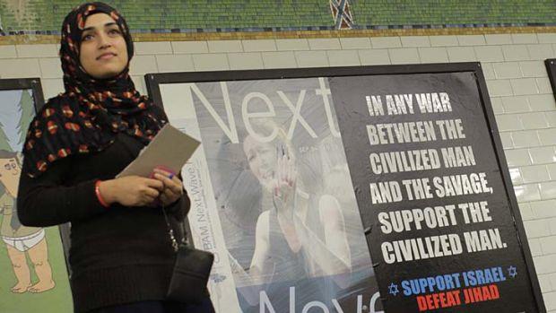Spreading the news ... Muslim-American Javeraea Khan hands out pamphlets challenging the ''Support Israel, Defeat ...