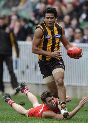 Catch me if you can: Former schoolmates Cyril Rioli and Nick Smith in action in the AFL.