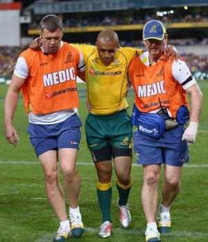 Wallaby Will Genia is helped from the field with an injury during Rugby Championship match between Australia and the ...