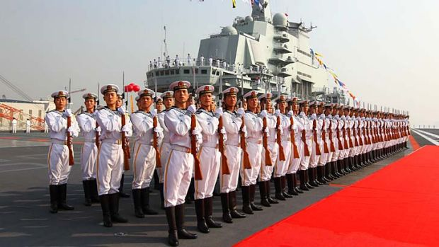 Naval honour guards stand awaiting a review on China's aircraft carrier Liaoning.