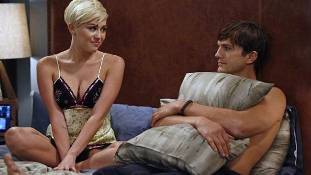 Wild child ... Miley Cyrus and Ashton Kutcher in an upcoming episode of Two and a Half Men.