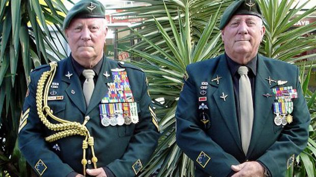 Twins John and George Hines, 68, at the 2012 ANZAC Day parade in Brisbane.