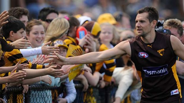Back in the game: Hawthorn's Luke Hodge with fans during the final training session before tomorrow's Grand Final.