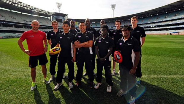 Select group: AFL ambassador Tadgh Kennelly (left) with international prospects.