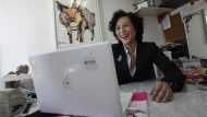 Gigi Chao, the daughter of Hong Kong property tycoon Cecil Chao Sze-tsung, reacts while reading marriage proposal emails ...