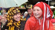 Footy fans out in force for rainy parade (Video Thumbnail)